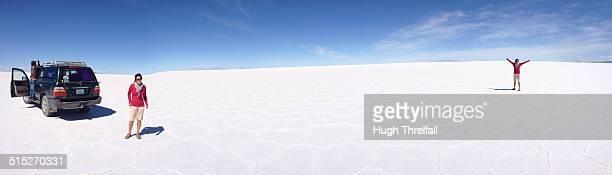 Largest salt lake in the world near Uyuni Bolivia Woman in panorama twice