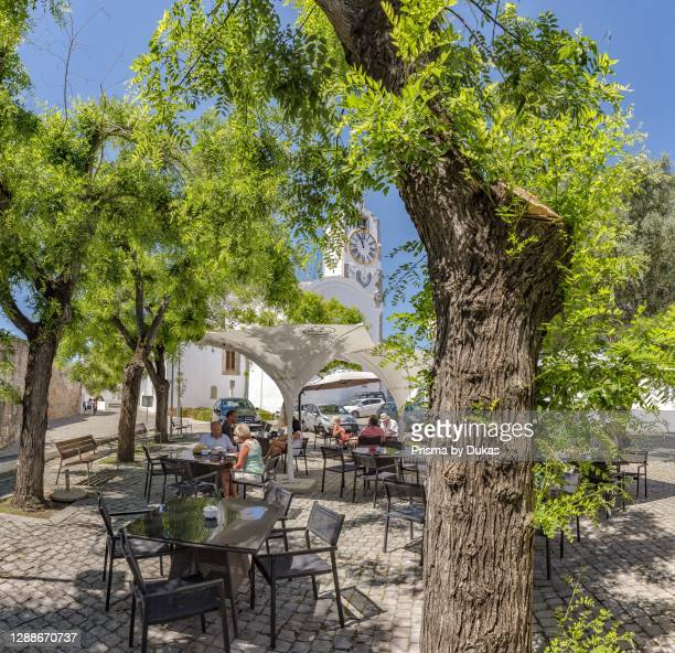 Largo da Misericordia square with an outdoor cafe underneath the canopy, Tavira, Portugal.