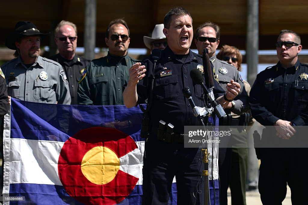 Larimer County Sheriff Justin Smith speaks to a crowd  Sheriffs from