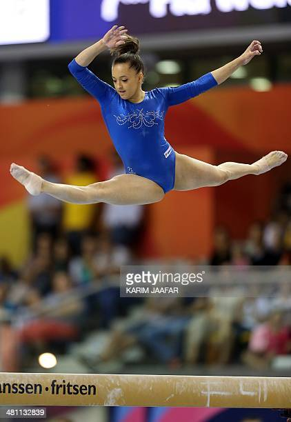 Larisa Andreea Iordache of Romania performs on the beam during the 7th Doha Art Gymnastics World Cup at the Aspire Academy in the Qatari capital Doha...