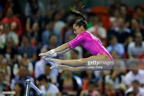 Larisa Andreea Iordache of Romania performs on the uneven bars during the Women's AllAround Final in day four of the 45th Artistic Gymnastics World...