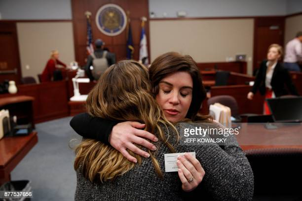 Larissa Boyce gets a hug from Alexis Alvarado both victims of Larry Nassar during a hearing in Ingham County Circuit Court on November 22 2017 in...