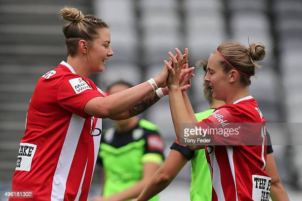 Larissa Crummer and Marianna Tabain of Melbourne City celebrate a goal during the round four WLeague match between Canberra United and Melbourne City...