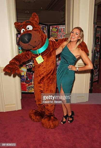 Larissa Eddie poses with ScoobyDoo at the press night after party for ScoobyDoo Live Musical Mysteries at The London Palladium on August 18 2016 in...