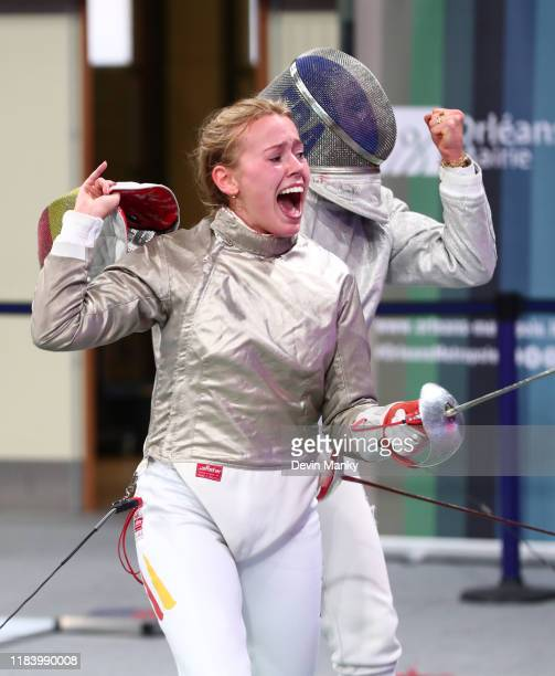 Larissa Eifler of Germany celebrates a victory over Coline Suzanne of France during the preliminary rounds of competition at the Women's Sabre World...