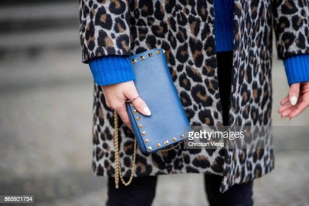 Larissa Laudenberger wearing a coat with leo print Topshop white ankle boots Zara blue knit Diane von Furstenberg blue Valentino mini bag sunglasses...