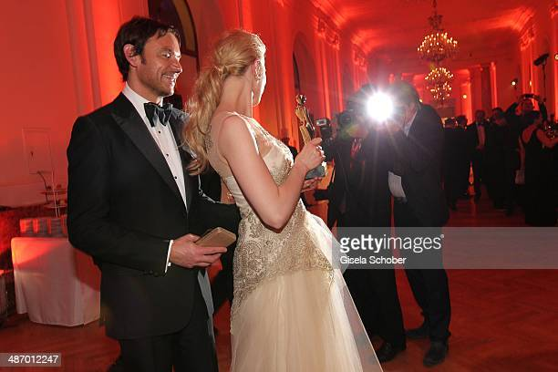 Larissa Marolt and her boyfriend Whitney Sudler Smith attend the 25th Romy Award 2014 at Hofburg Vienna on April 26 2014 in Vienna Austria