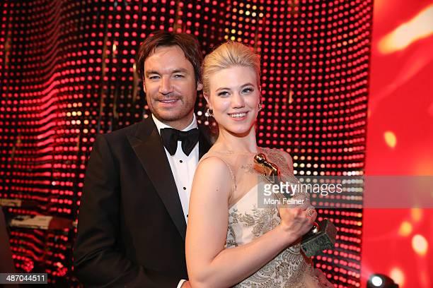 Larissa Marolt and her boyfriend Whitney SudlerSmith attend the Romy Award 2014 at Hofburg Vienna on April 26 2014 in Vienna Austria