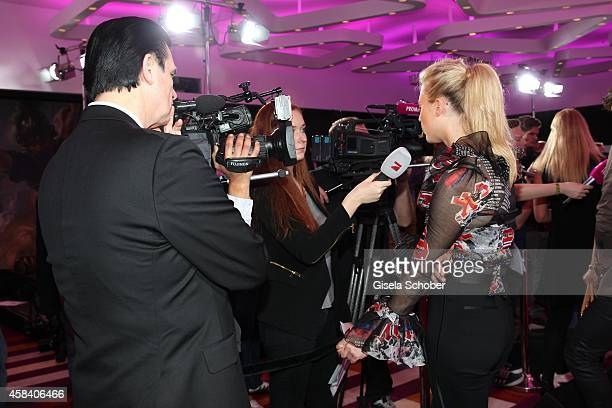 Larissa Marolt and her father and manager Heinz Anton Marolt attend the CLOSER Magazin Hosts SMILE Award 2014 at Hotel Vier Jahreszeiten on November...