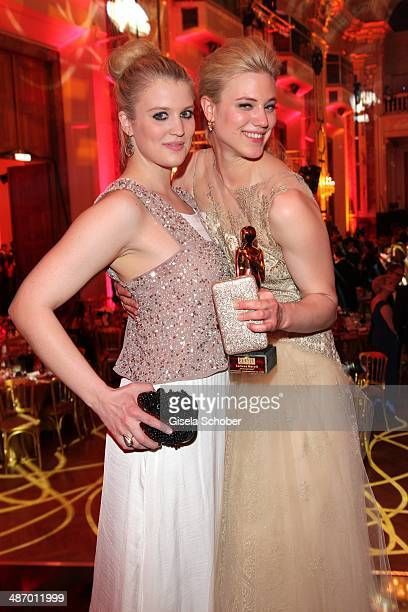 Larissa Marolt and her sister Lisa Marie attend the 25th Romy Award 2014 at Hofburg Vienna on April 26 2014 in Vienna Austria