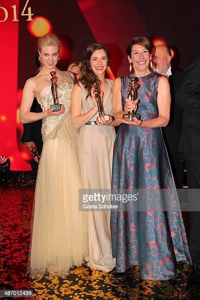 Larissa Marolt Miriam Stein and Adele Neuhauser attend the 25th Romy Award 2014 at Hofburg Vienna on April 26 2014 in Vienna Austria