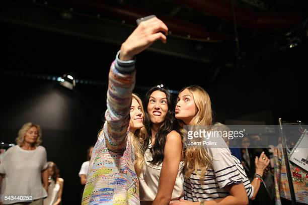 Larissa Marolt Rebecca Mir and Elena Carriere take a selfie backstage ahead of the Riani show during the MercedesBenz Fashion Week Berlin...