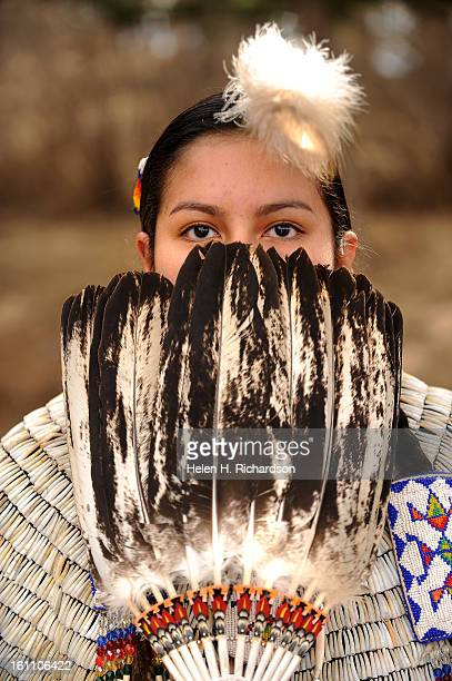 Larissa No Braid part Arikaree and part Lakota gets prepared to perform a traditional dance outside the museum The feathers she is holding is a wing...