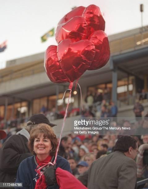 SIMON 2/14/99 Lark Chastain mother of US soccer team's Brandi Chastain holds balloons for her daughter before the start of the US vs World AllStars...