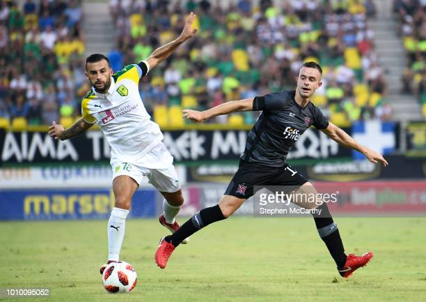 Larnaca Cyprus 2 August 2018 Robbie Benson of Dundalk and Ivan Trikovski of AEK Larnaca during the UEFA Europa League Second Qualifying Round 2nd Leg...