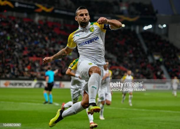 AEK Larnaca's Macedonian midfielder Ivan Trickovski celebrates scoring the opening goal during the UEFA Europe League Group A football match Bayer...