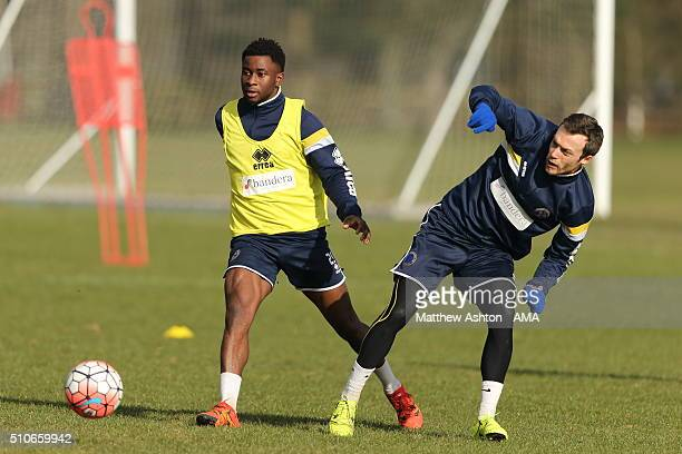 Larnell Cole and Shaun Whalley of Shrewsbury Town during a training session ahead of their FA Cup tie against Manchester United at the Lilleshall...