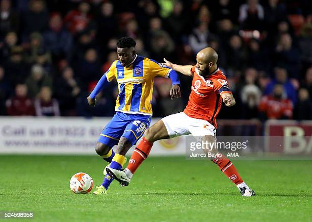 Larnell Cole of Shrewsbury Town and Adam Chambers of Walsall during the Sky Bet League One match between Walsall and Shrewsbury Town at Bescot...