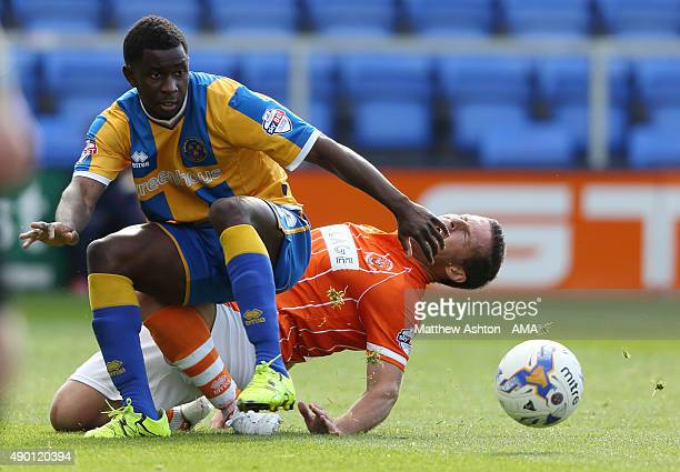Larnell Cole of Shrewsbury Town and David Norris of Blackpool during the Sky Bet League One match between Shrewsbury Town and Blackpool at New Meadow...