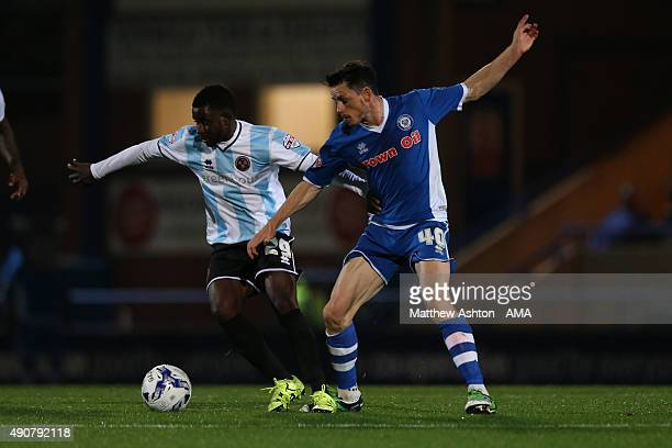 Larnell Cole of Shrewsbury Town and Ian Henderson of Rochdale during the Sky Bet League One match between Rochdale and Shrewsbury Town at Spotland...