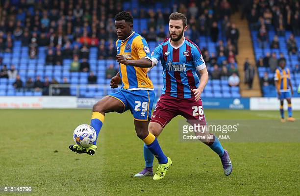 Larnell Cole of Shrewsbury Town and Jamie Ness of Scunthorpe United during the Sky Bet League One match between Shrewsbury Town and Scunthorpe United...