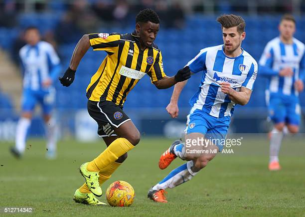 Larnell Cole of Shrewsbury Town and Joe Edwards of Colchester United during the Sky Bet League One match between Colchester United and Shrewsbury...
