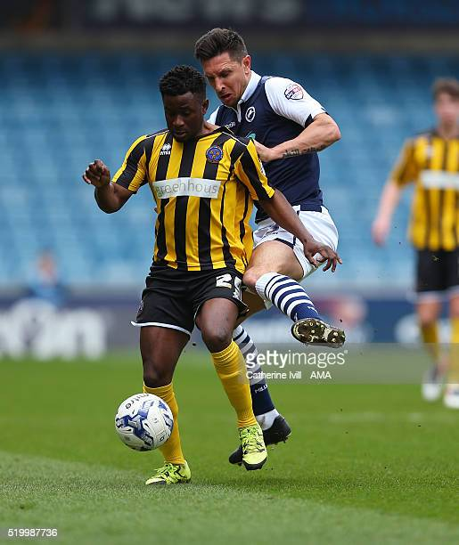 Larnell Cole of Shrewsbury Town and Joe Martin of Millwall during the Sky Bet League One match between Millwall and Shrewsbury Town at The Den on...