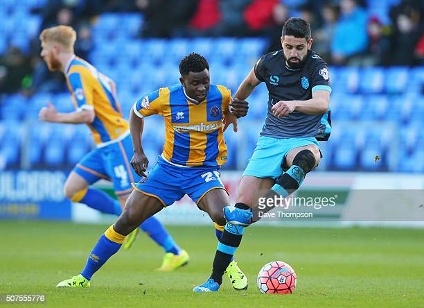 Larnell Cole of Shrewsbury Town and Marco Matias of Sheffield Wednesday compete for the ball during the Emirates FA Cup Fourth Round match between...