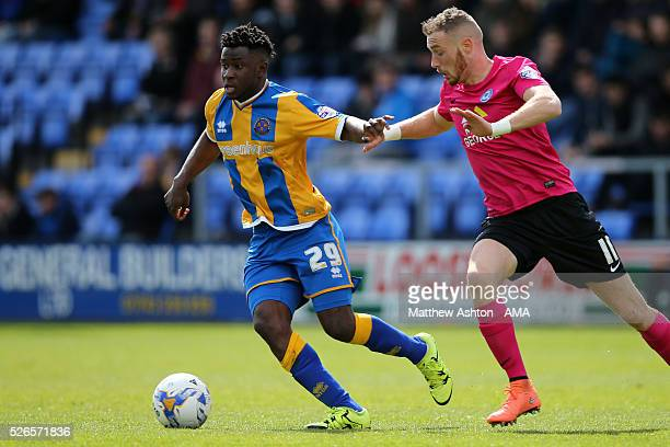 Larnell Cole of Shrewsbury Town and Marcus Maddison of Peterborough Unitedduring the Sky Bet Football League One match between Shrewsbury Town and...