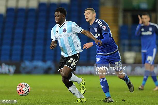 Larnell Cole of Shrewsbury Town and Stuart O'Keefe of Cardiff City during The Emirates FA Cup match between Cardiff City and Shrewsbury Town at...