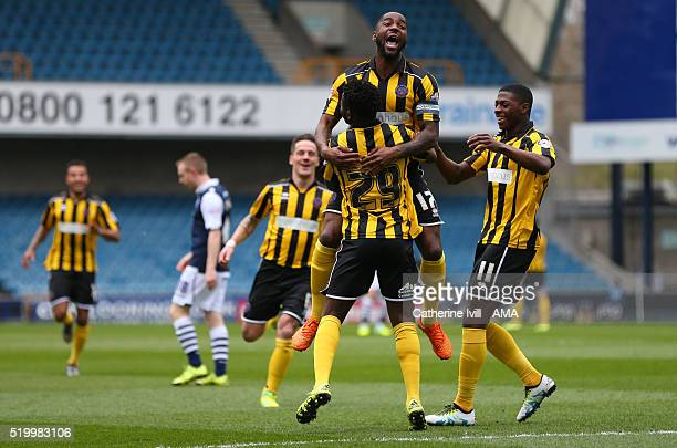 Larnell Cole of Shrewsbury Town celebrates after he scores a goal to make it 01 with Abu Ogogo and Sullay Kaikai of Shrewsbury Town during the Sky...