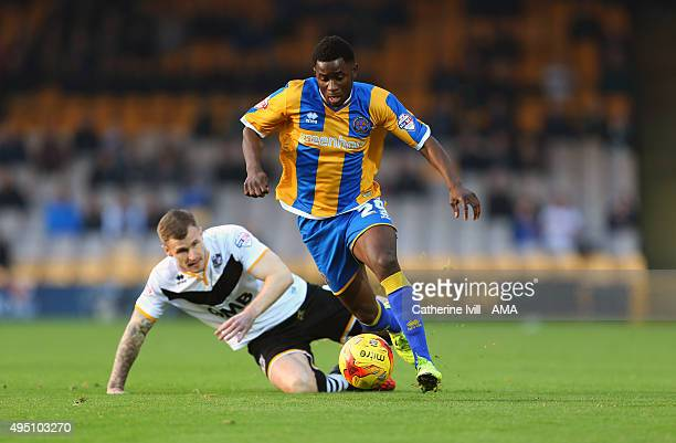 Larnell Cole of Shrewsbury Town gets past Michael O'Connor of Port Vale during the Sky Bet League One match between Port Vale and Shrewsbury Town at...
