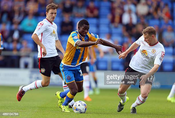 Larnell Cole of Shrewsbury Town in action with Chris Atkinson and Stephen Kingsley of Crewe Alexandra during the Sky Bet League One match between...