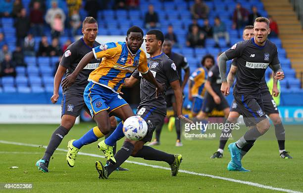 Larnell Cole of Shrewsbury Town in action with Reece Brown Jacob Mellis and Chris Hussey of Bury during the Sky Bet League One match between...