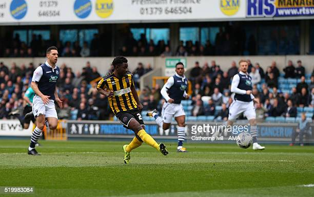 Larnell Cole of Shrewsbury Town scores a goal to make it 01 during the Sky Bet League One match between Millwall and Shrewsbury Town at The Den on...