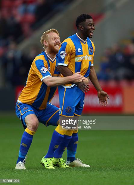 Larnell Cole of Shrewsbury Town scores a goal to make it 01 with Zak Whitbread of Shrewsbury Town during the Sky Bet League One match between Crewe...