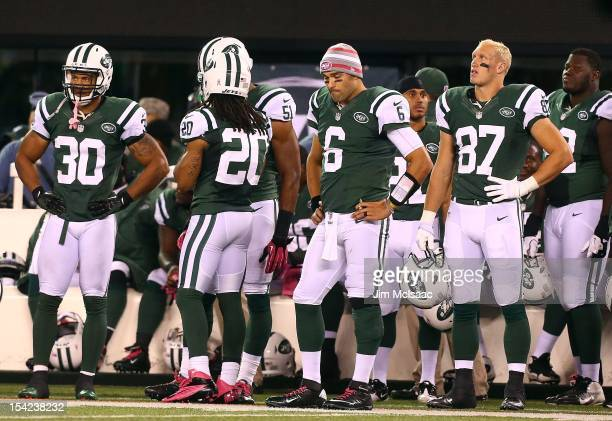 LaRon Landry Mark Sanchez and Konrad Reuland of the New York Jets look on against the at MetLife Stadium on October 8 2012 in East Rutherford New...