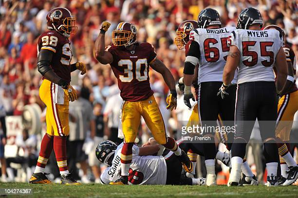 LaRon Landry of the Washington Redskins celebrates a sack of Matt Schaub of the Houston Texans at FedExField on September 19 2010 in Landover...