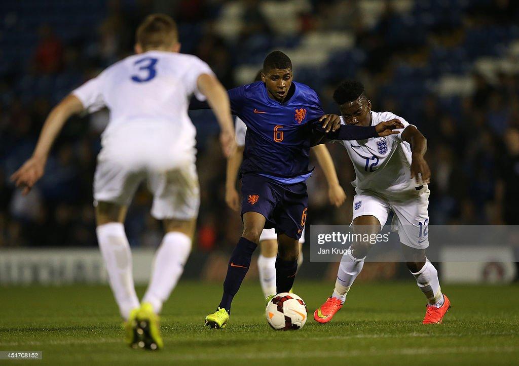 Laros Duarte of Netherlands U18 holds off England U18 Joshua Onomah of during the U18 International Friendly match between England U18 and Netherlands U18 at JD Stadium on September 5, 2014 in Bury, England.