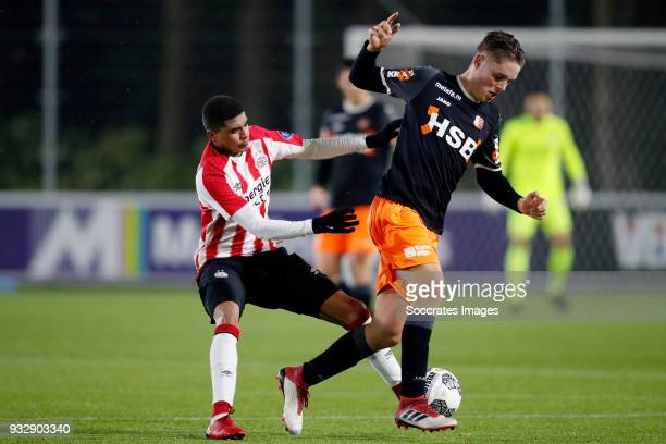 Laros Duarte of PSV U23 Enzo Stroo of FC Volendam during the Dutch Jupiler League match between PSV U23 v FC Volendam at the De Herdgang on March 16...