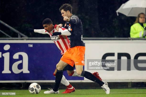 Laros Duarte of PSV U23 Gerry Vlak of FC Volendam during the Dutch Jupiler League match between PSV U23 v FC Volendam at the De Herdgang on March 16...