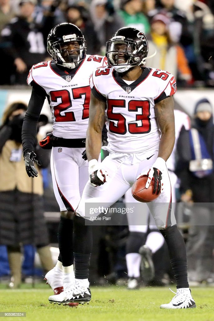LaRoy Reynolds #53 and Damontae Kazee #27 of the Atlanta Falcons react after recovering the ball in a muffed punt return by the Philadelphia Eagles during the NFC Divisional Playoff game game at Lincoln Financial Field on January 13, 2018 in Philadelphia, Pennsylvania.
