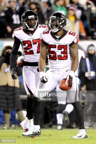 LaRoy Reynolds and Damontae Kazee of the Atlanta Falcons react after recovering the ball in a muffed punt return by the Philadelphia Eagles during...