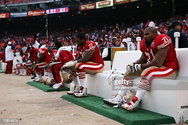 Larry Allen of the San Francisco 49ers sit on the bench against the Arizona Cardinals during an NFL game at Monster Park on December 24 2006 in San...