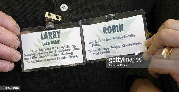 Larry and Robin Emerson new owner's of Carisle's only store Fern's Country Store wear name tags with some information about themselves