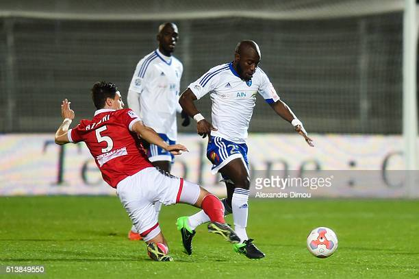 Larry Azouni of Nimes and Alliou Dembele of Bourg en Bresse during the French Ligue 2 between Nimes v Bourg en Bresse at Stade des Costieres on March...