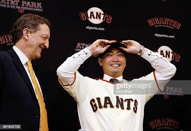 Larry Baer, President and CEO of the San Francisco Giants introduces Norichika Aoki during a press conference at AT&T Park on January 20, 2015 in San...