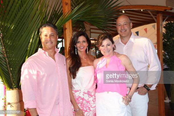 Larry Baum Maria Baum Lisa Pevaroff Cohn and Gary Cohn attend the 2018 Hamptons Paddle Party for Pink to benefit the Breast Cancer Research...