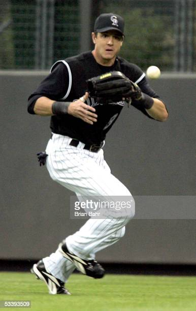 Larry Bigbie of the Colorado Rockies fields the ball against the Pittsburgh Pirates on August 9 2005 at Coors Field in Denver Colorado The Pirates...