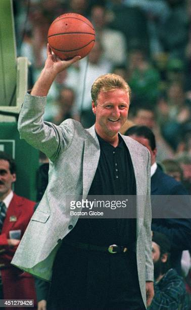 Larry Bird acknowledges the applause after shooting a hoop at Celtics Legends night